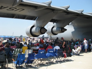 Hundreds found shade under the wings of giant aircraft.  Not us!